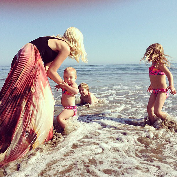 "Tori Spelling hit the beach with her tots on Mother's Day, saying, ""Who said a gown isn't appropriate swimwear... #momista #momwarrior #mothersday"" Source: Instagram user torianddean"