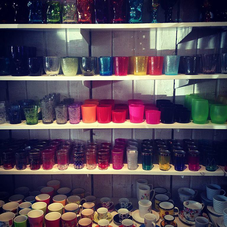 See the rainbow and take your pick from the colorful tumblers waiting to serve up cocktails at Maison Midi.