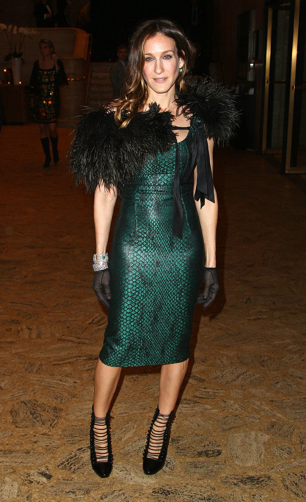 Parker sizzled in an emerald python L'Wren Scott sheath, fur shawl, sheer gloves, and caged booties for a Winter ballet ball in March 2009.