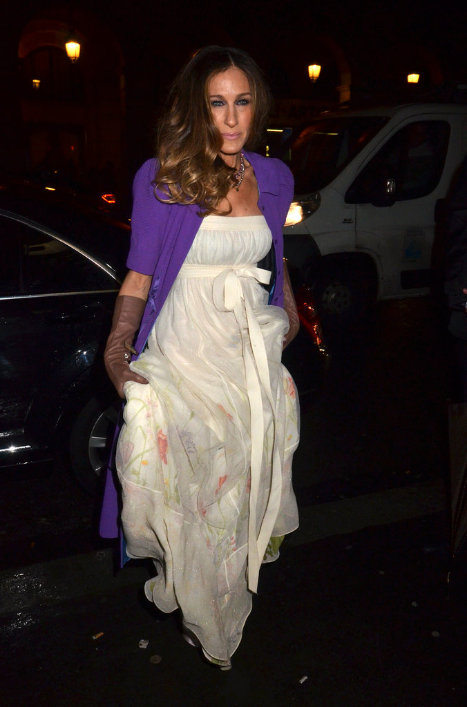 Sarah Jessica Parker roughed up her floral-print Louis Vuitton gown with a cropped purple jacket and long leather gloves during Paris Fashion Week in 2012.