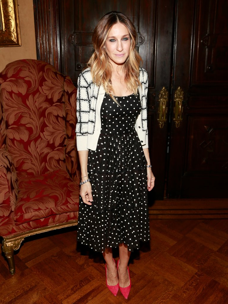 SJP mixed prints like a pro, layering a windowpane cardigan over her polka-dot midi dress at the 10th annual Love 'N' Courage Benefit in February.