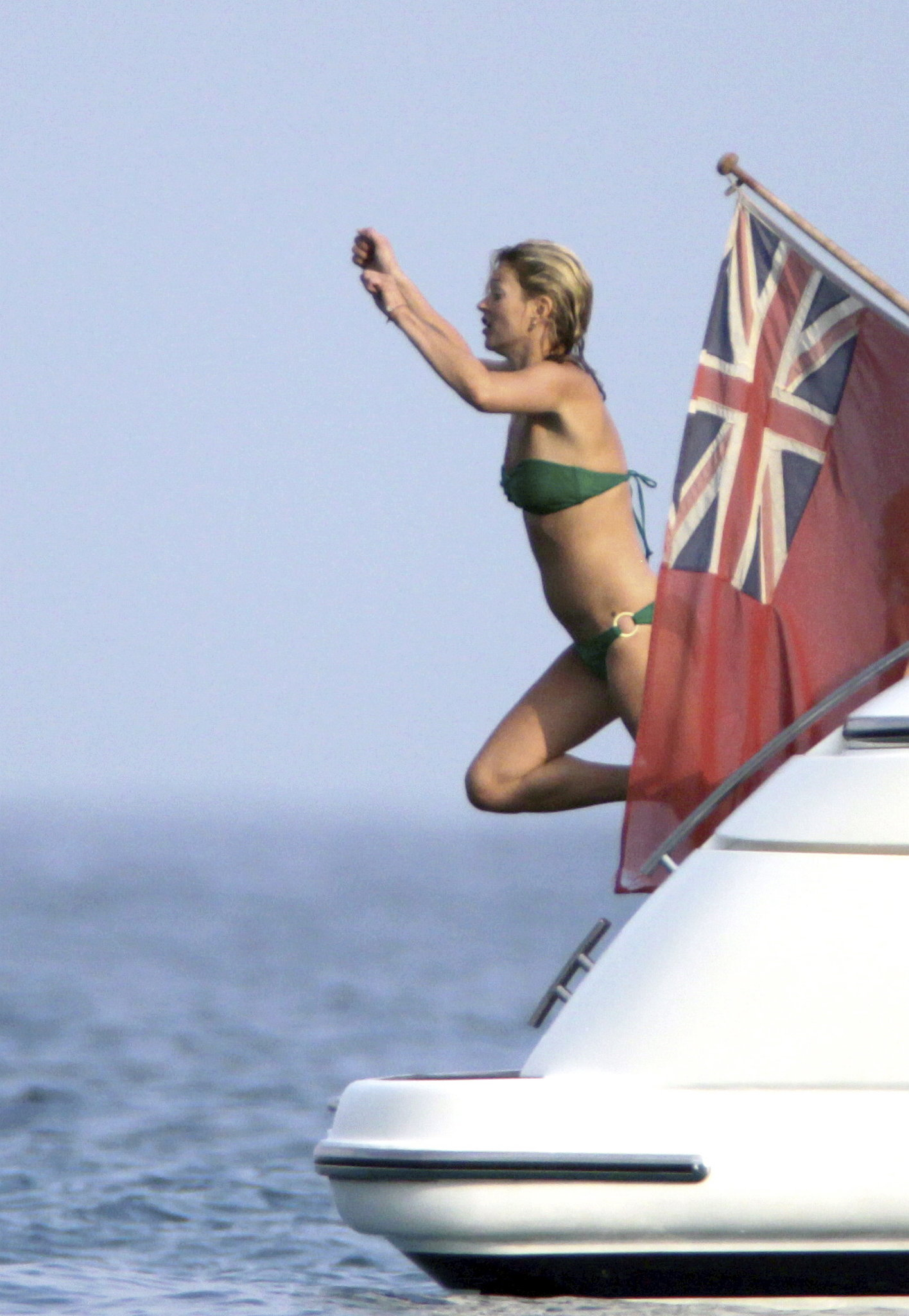 Kate Moss leaped from a yacht while vacationing in St. Tropez with Lily Allen in 2009.