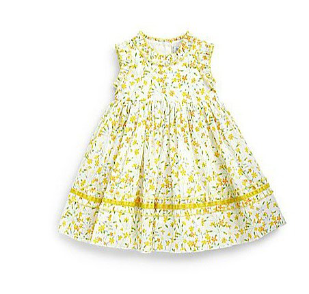 Here comes the sun! Baby CZ's yellow Liberty print dress and bloomer set ($188) is as bright and cheery as they come.