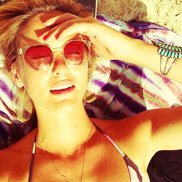 Bar Refaeli lounged in the sun and shaded her face with a very cool pair of retro sunglasses. Source: Instagam user barrefaeli