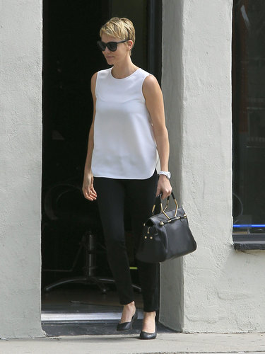 Charlize Theron paired a crisp white sleeveless tank with black skinny jeans and a Viktor & Rolf bag in LA.  Shop our favorite black-and-white pieces below: