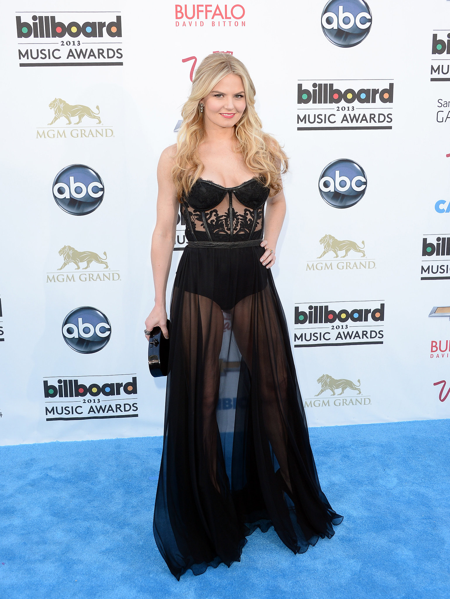 Jennifer Morrison turned heads in a very sexy Kristian Aadvenik dress. Between the corseted bodice and sheer skirt, there are quite a few skin-revealing elements to take in. She then added a black Edie Parker clutch to match.