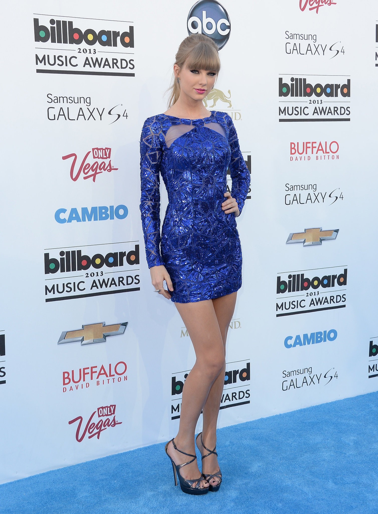 Taylor Swift showed off her legs in a vibrant blue Zuhair Murad minidress from the Pre-Fall '13 collection. She matched the sapphire hue with Ofira earrings and ring.