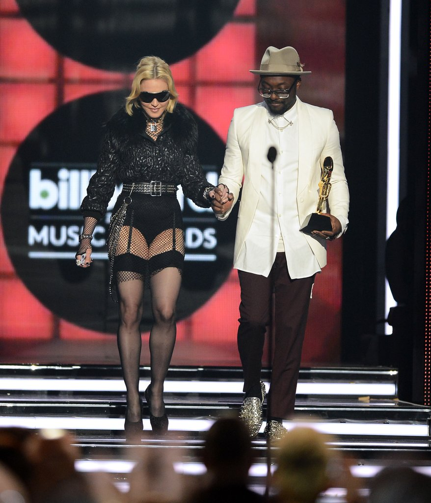Like her Met Gala getup, Madonna dared to go punk again in Givenchy Haute Couture while accepting an award for Top Touring Artist on stage at the Billboard Awards. She wore a plush fur-accented jacket over a black leotard, then added more daring details: sheer stockings, wraparound sunglasses, a studded belt, a padlock choker, and an oversize ring.