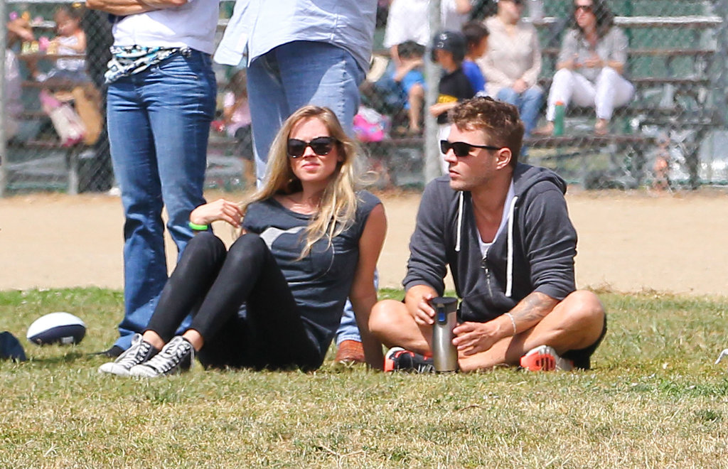 Reese and Ryan Bring Plus-Ones For a Saturday on the Sidelines