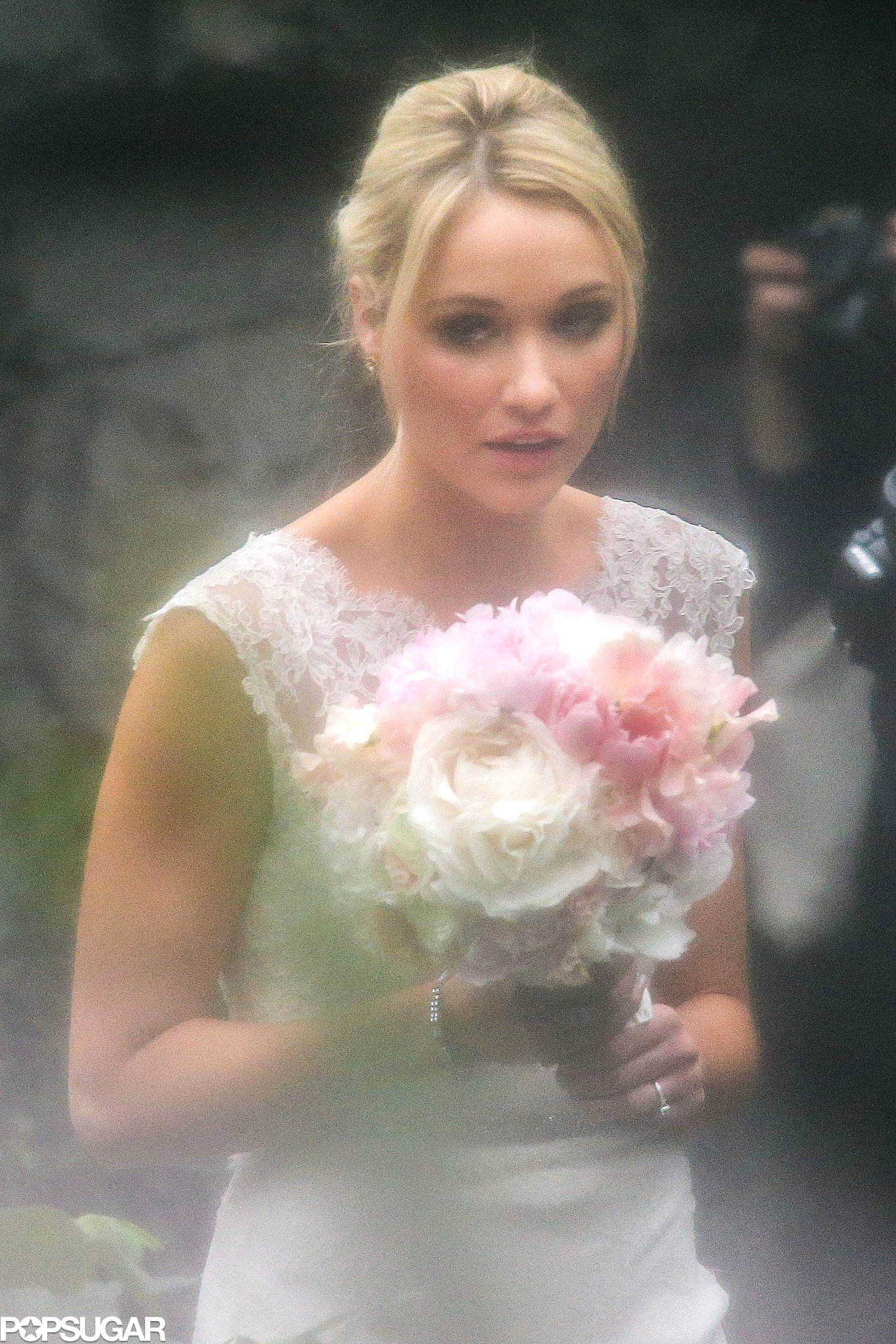 Katrina Bowden walked down the aisle in a white lace wedding gown.