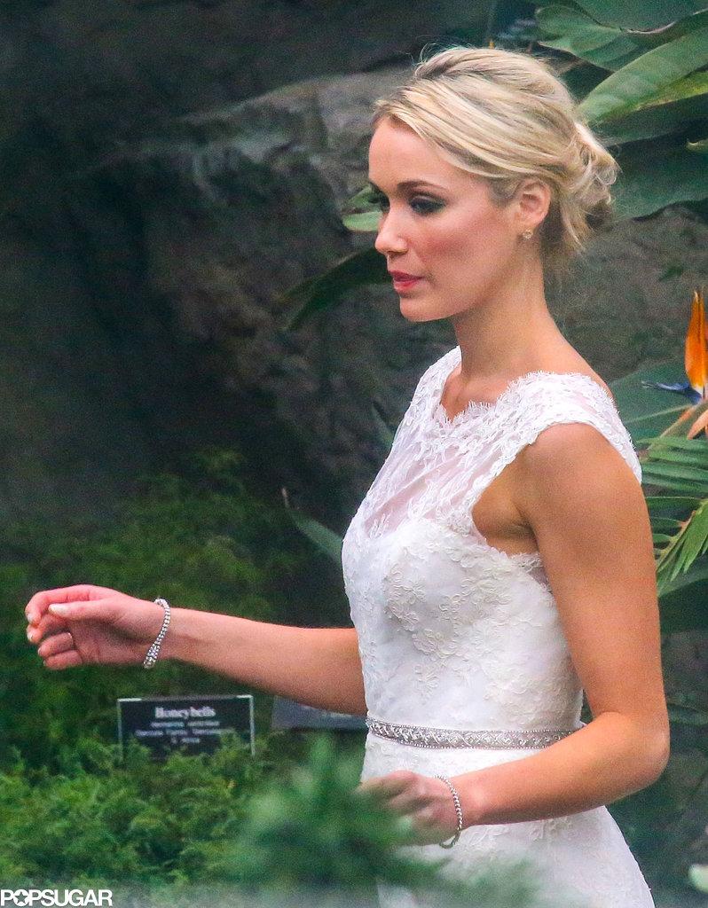 Katrina Bowden wore a white lace wedding dress.