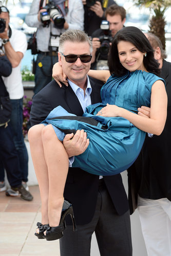 Alec Baldwin carried Hilaria Thomas on Tuesday at a Seduced and Abandoned photocall in Cannes.