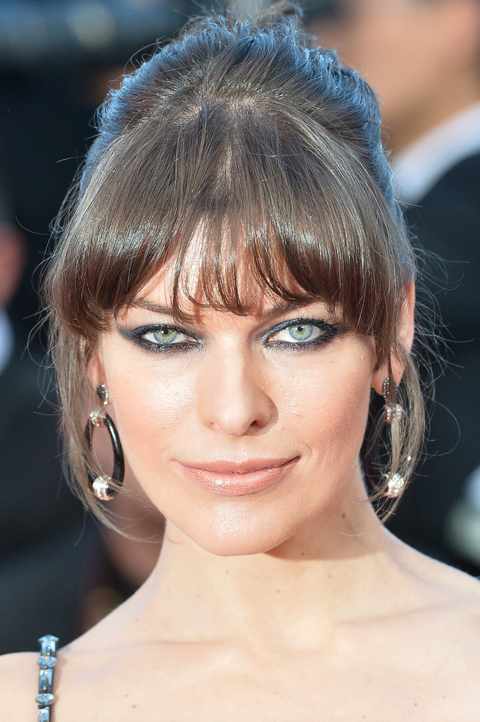 Milla Jovovich outfitted her evening gown with oversize hoop earrings.