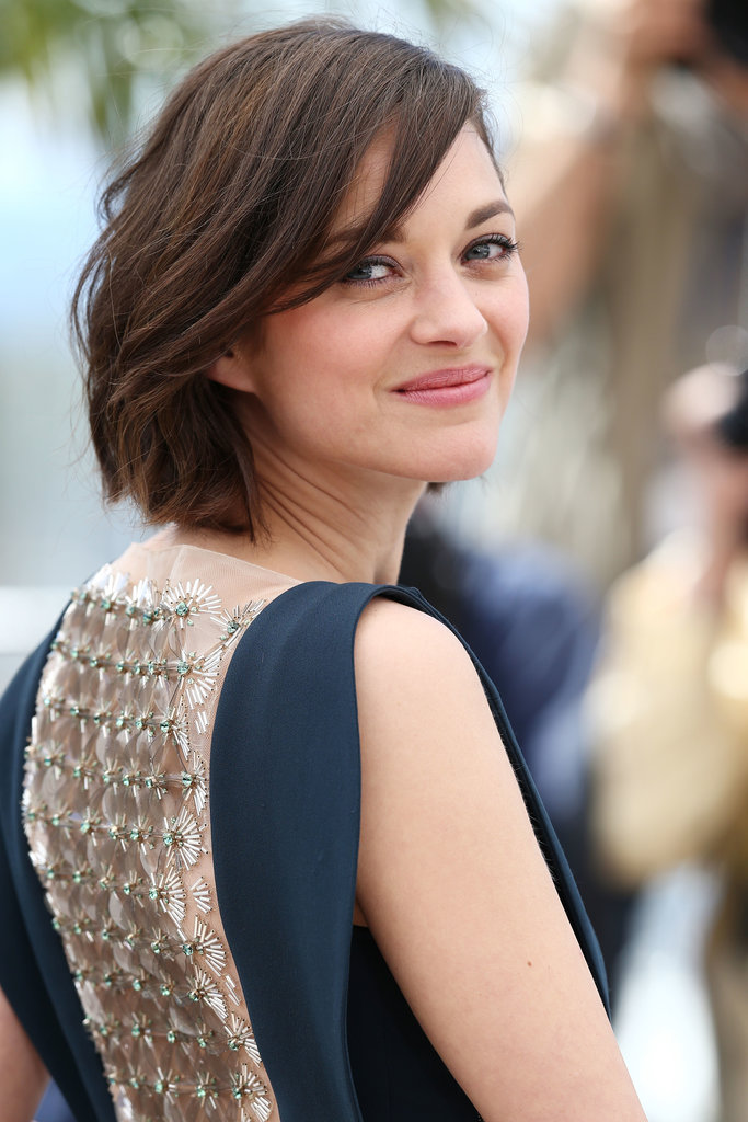 Co-star Marion Cotillard wore her newly chopped hair in a gentle wave, too. She makes us want to snip!