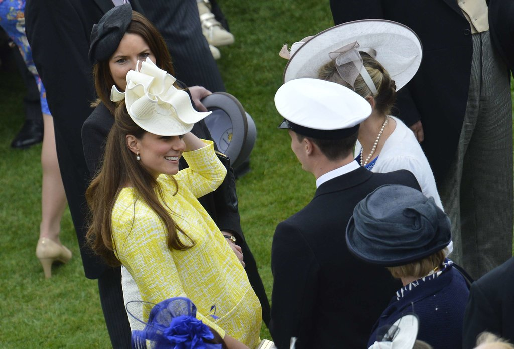 Kate held on to her fascinator.