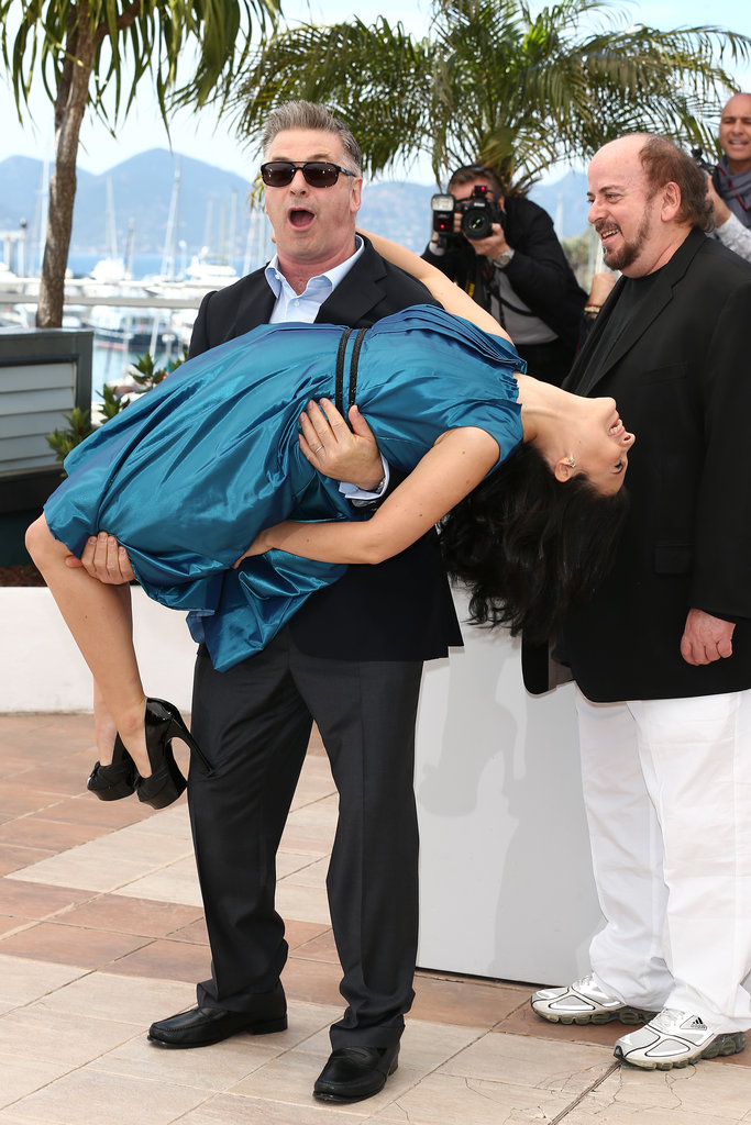 Alec Baldwin lifted his wife Hilaria at the photo call for Seduced and Abandoned.