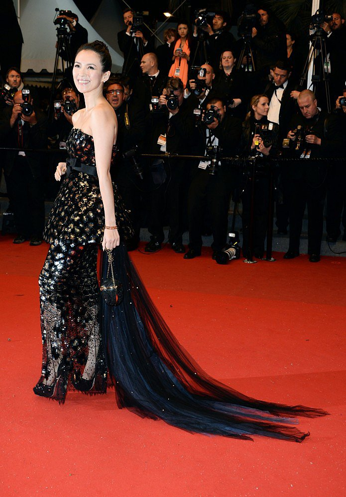 For the Only God Forgives premiere, Zhang Ziyi picked an embellished black Chanel Haute Couture dress with a dramatic train, and carried a black Ferragamo clutch.
