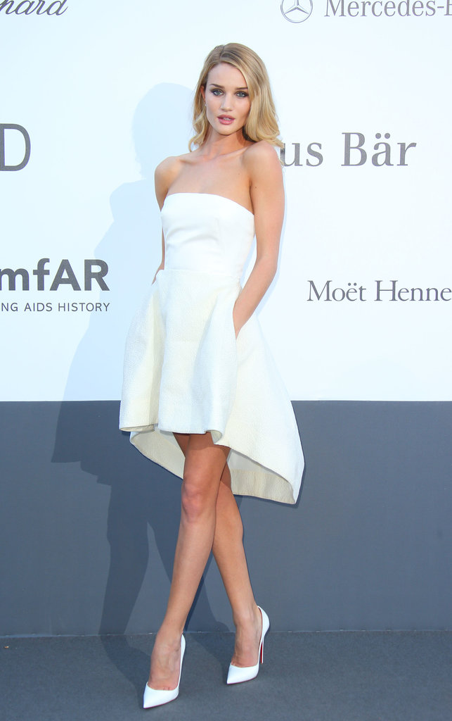 Rosie Huntington-Whiteley took a shorter approach than the rest of the amfAR attendees in a little white strapless Dior bustier and skirt with matching white Christian Louboutin pumps.