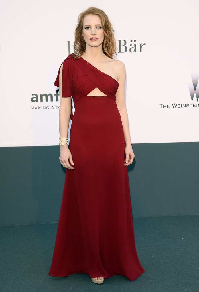 Jessica Chastain chose a deep red, one-shoulder Saint Laurent cutout gown that matched her tresses perfectly.