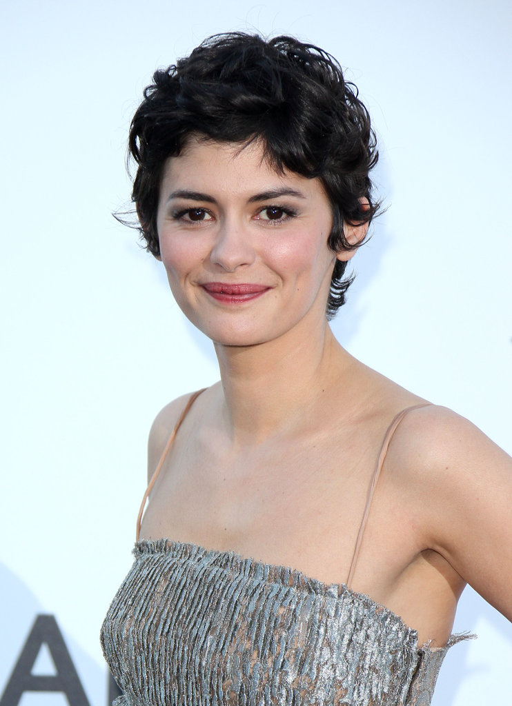 With rosy lips, gray eye shadow, and her curly pixie, Audrey Tautou shone on the red carpet.