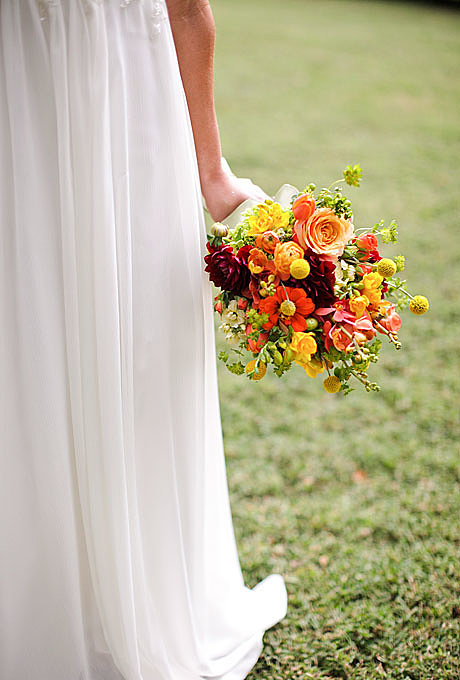 A Laid-Back Late-Summer Bouquet This free-form bouquet was created by the folks at Nashville-based event-design company Cedarwood Weddings. (FYI: they have a fab barn on a 50-acre nature preserve, for those of you in the area.) What makes this a modern bouquet? For starters, they've blended what are considered to be more exotic flowers like mokara orchids with garden-variety flowers like zinnias and herbs, and that they've incorporated so many different blooms in a single arrangement. The 10 flowers used here (cream stock, wine dahlias, tulips, mokara orchids, freesia, ranunculus, roses, spray roses, zinnias, and craspedia) are in season in late Summer. Browse more modern wedding flower ideas. Read the rest of the story: Floral Inspiration For a Summer Wedding Related: Top 20 Honeymoon Resorts in the United States Source: Austin Gros Photography