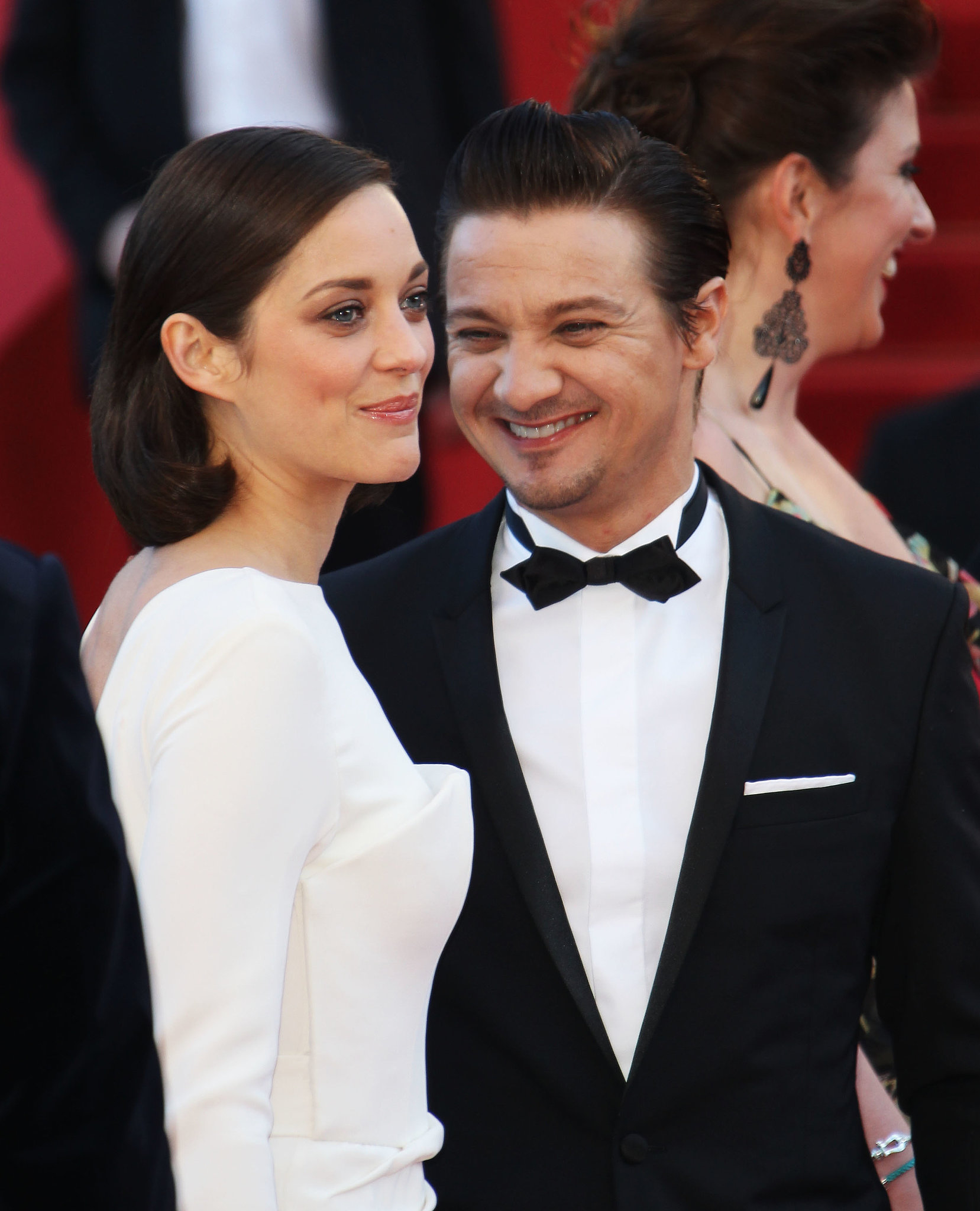 Jeremy Renner smiled at his costar Marion Cotillard at the premiere for The Immigrant on Friday.