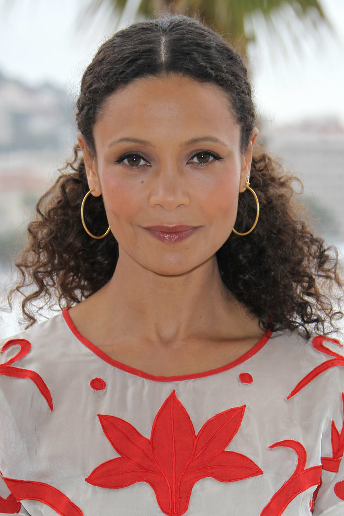 Women with curly hair sometimes have too much hair to fit in one rubberband. Take a note from Thandie Newton's style book and use bobby pins to secure hair behind the ears in a faux ponytail.