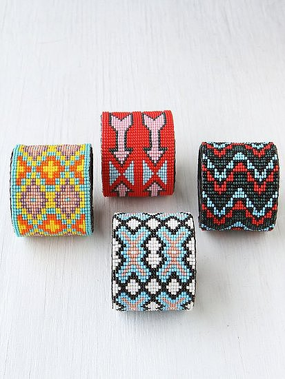 These Free People beaded design cuffs ($28) would look amazing with a white sundress and a tan.