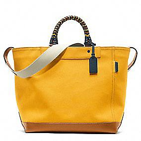 The Bleecker canvas tote ($448) from Coach is the perfect beach bag in my eyes. Its bright color, woven leather handle, and cavernous interior all make it a pleasure to carry to that perfect spot in the sand, and what's better is that its durable canvas construction will not only last multiple seasons, but it'll also look better with age.  — RK