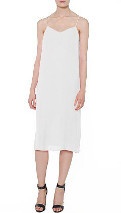 "The temperatures are rising, and I can't think of anything better to wear than this Tibi slip dress ($310). It's aptly name the ""perfect slip dress,"" and I can't wait to wear it with a light vest and nude sandals for a day at work and with bold gold jewels later into the evening.  — CDC"