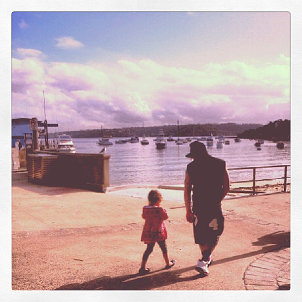 Joel Madden strolled along the harbor with little Harlow. Source: Instagram user nicolerichie