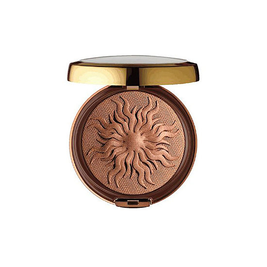 Bronzer isn't just for the face. Use Physicians Formula Bronze Booster ($14), which just happens to be stamped in a seasonally appropriate sun ray pattern, on your legs, décolletage, and arms for an allover glow.  — JR