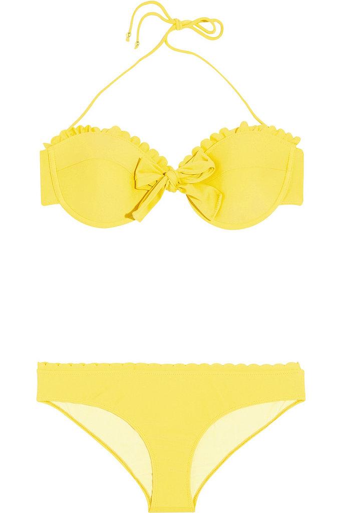 Make your next beach trip more stylish than the last in Miu Miu's cheery, scalloped bikini ($172, originally $245).