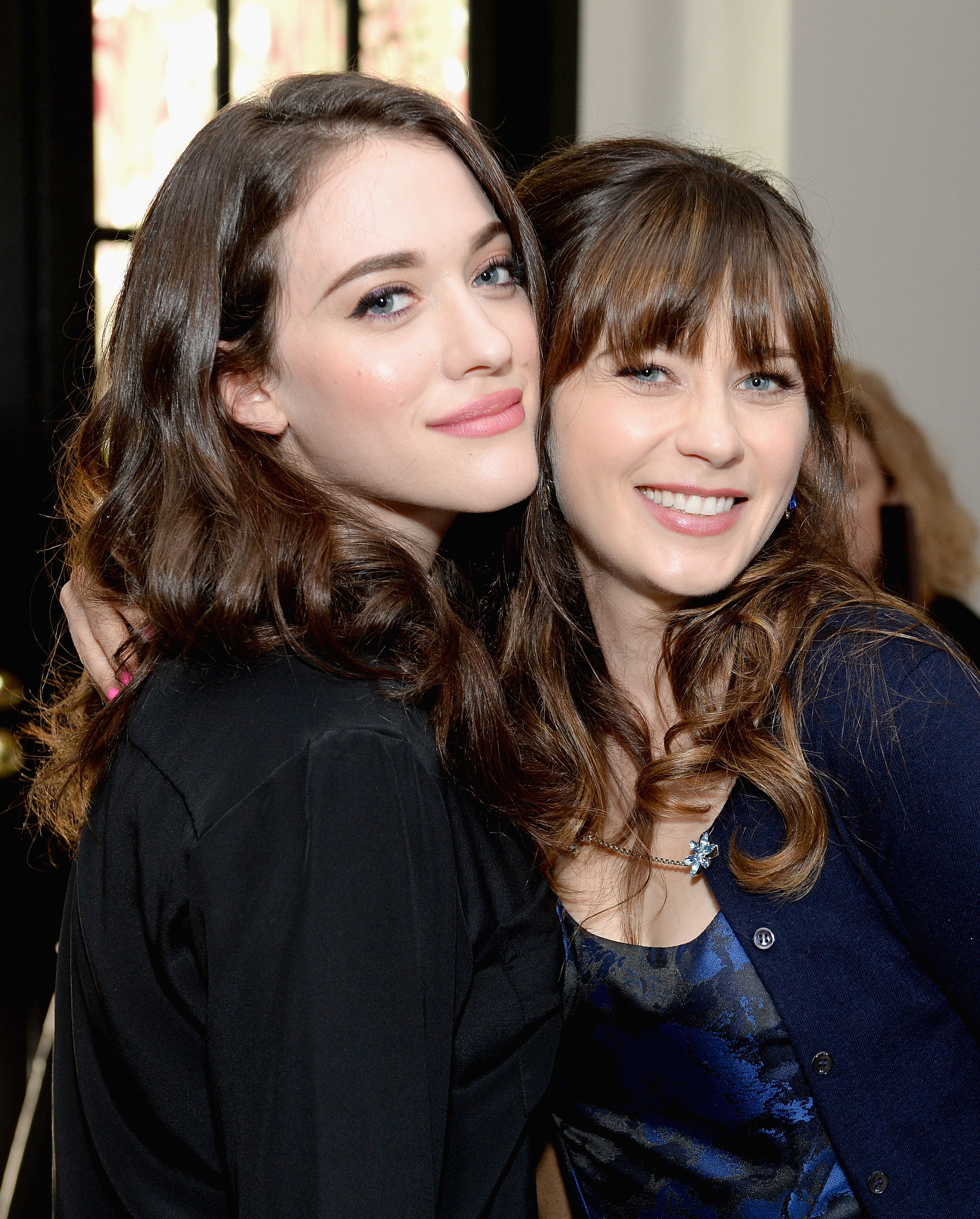 Both with glossy curls, Kat Dennings and Zooey Deschanel made a pretty pair after their panel. Kat opted for a peachy glow on her cheeks while Zooey flicked some inky black eyeliner across her lids.