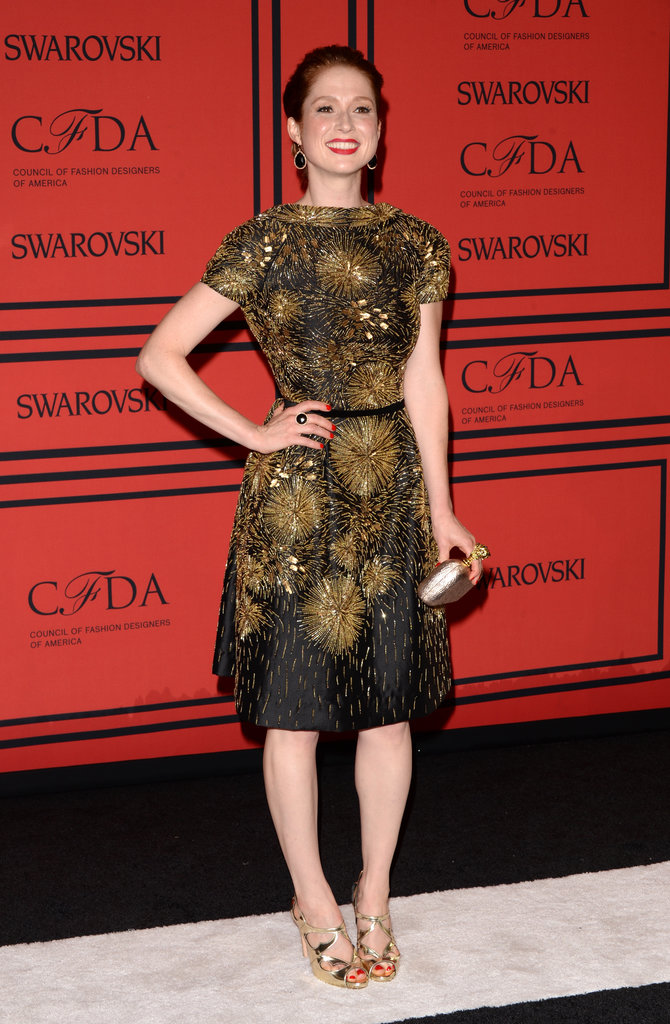 Ellie Kemper dazzled in a gold embellished fit-and-flare dress and gold strappy sandals.