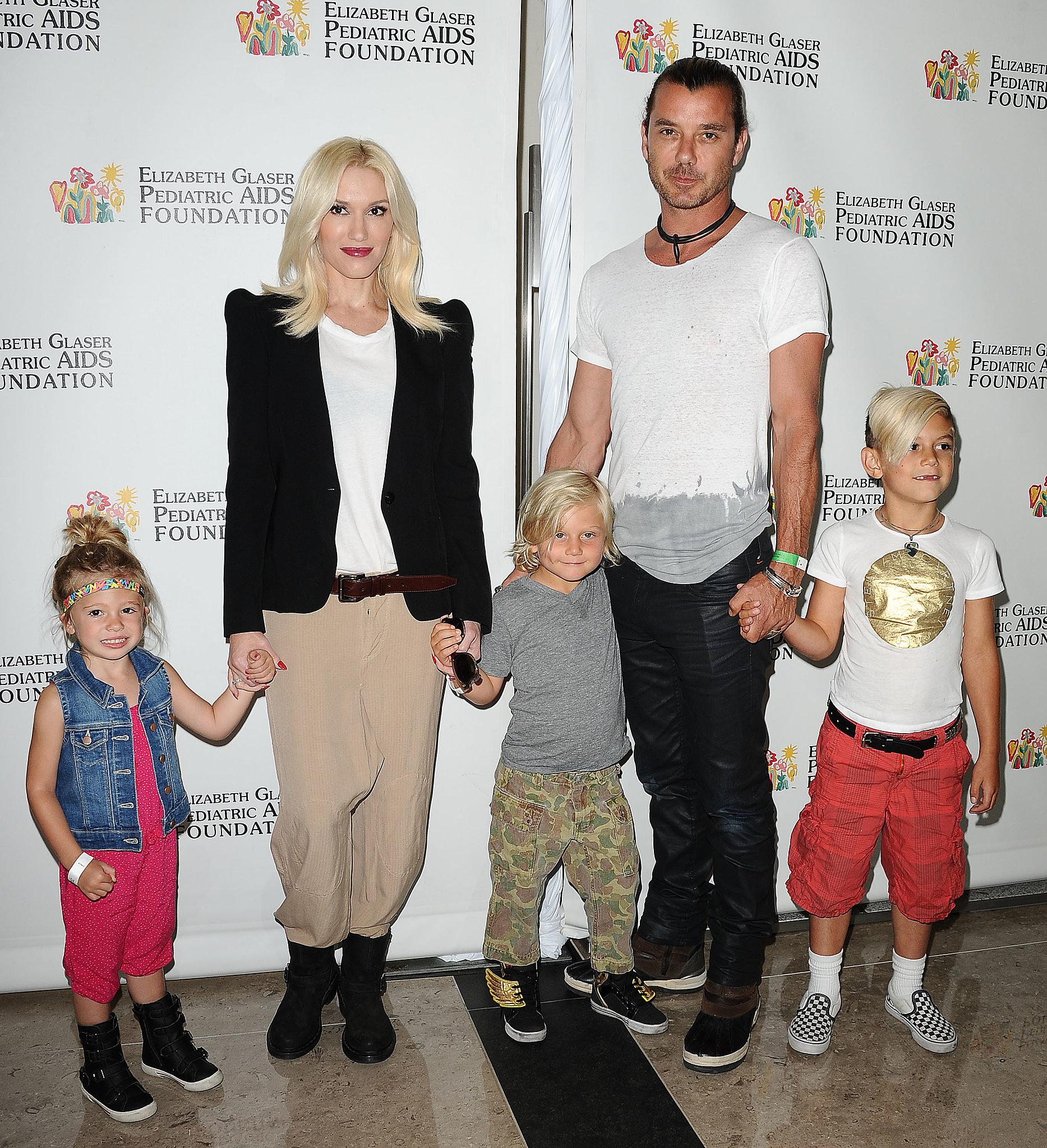Gwen Stefani and Gavin Rossdale held the children's hands.