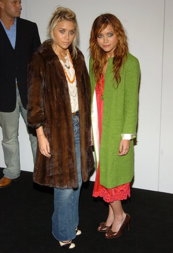Twinning combo: During Spring 2005 New York Fashion Week, the Olsens proved the power of statement outerwear, bundling up in two noteworthy coats.  Mary-Kate played the color card, layering an apple-green coat over her punchy slip dress.  Ashley warmed up in a luxe, chocolate-colored fur and light-wash denim.