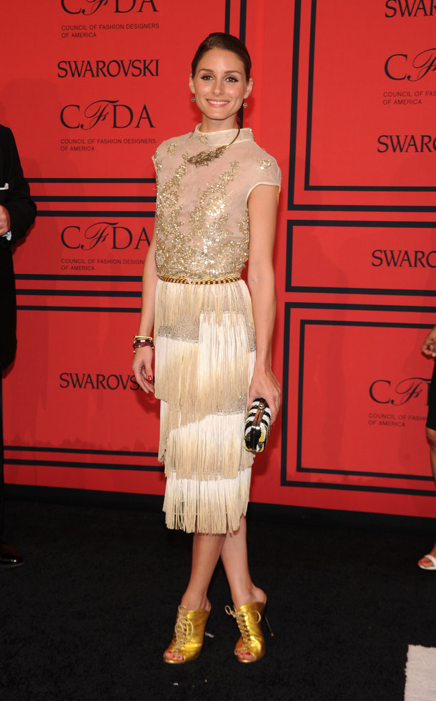 Olivia Palermo went the golden route, teaming this embellished Dennis Basso flapper frock back with her trusty gold lace-up heels.