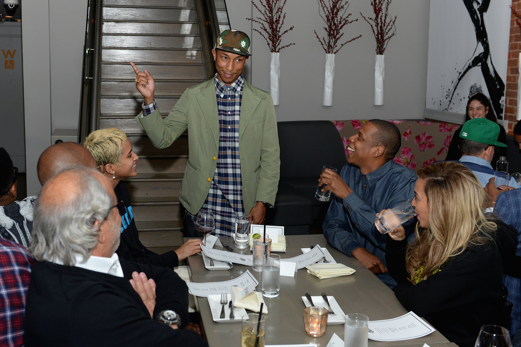 Pharrell Williams spoke to his guests inside the event.