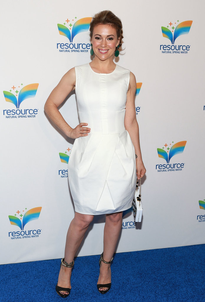 Alyssa Milano sported a sleeveless white dress with a tulip skirt with black chain-strap Aldo sandals and green earrings in NYC.