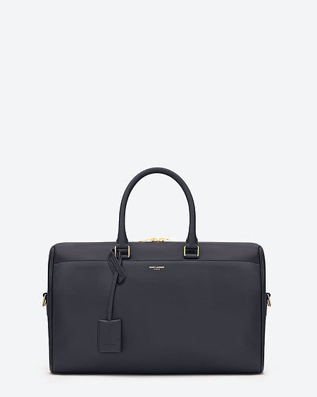 Duffle 12h in navy calfskin leather with suede lining ($2,650).