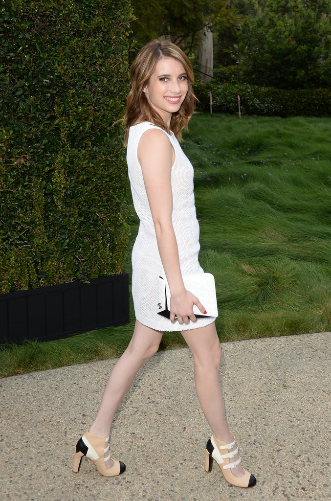 Emma Roberts strutted to a Chanel dinner in a white dress, a white quilted bag, and strappy cap-toe pumps, all by Chanel.