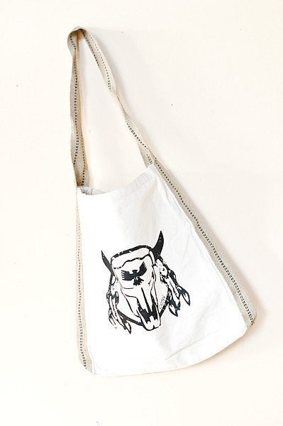 We love the folksy appeal of this sturdy Oxford Trunk Steer Tote ($37), and it'll fit right in at the bohemian Bonnaroo.
