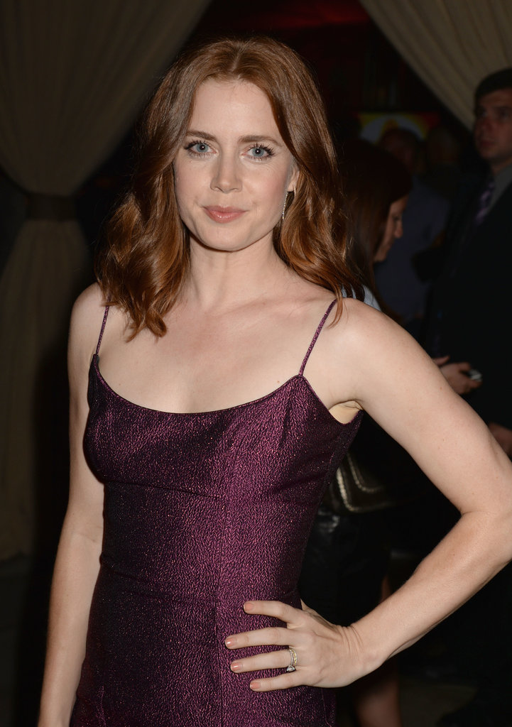 A pretty-in-pink makeup palette, soft waves, and peach-toned nail polish made up Amy Adams's Guys Choice Awards beauty look.