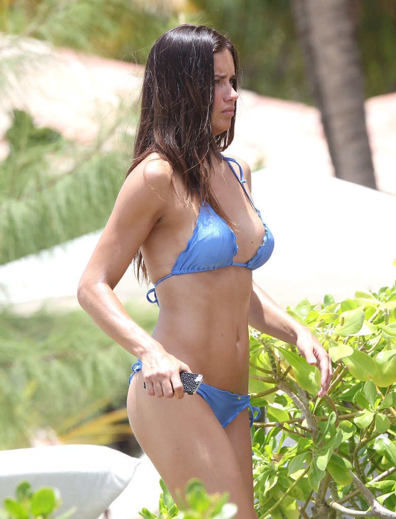Adriana Lima relaxed in a blue bikini while in St. Barts in May.
