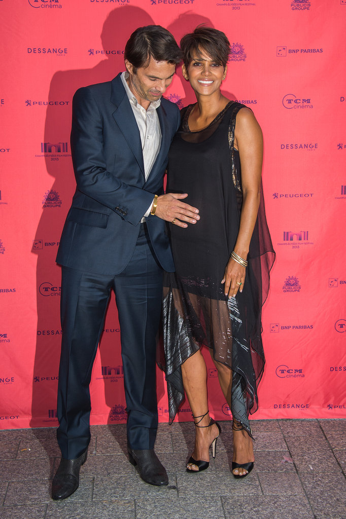 Pregnant Halle Berry hit the red carpet with her fiancé, Olivier Martinez, in Paris after he confirmed the news that they are expecting a son.