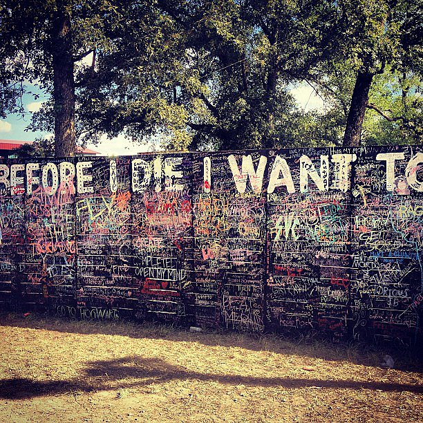 "Out of all of the amazing art projects at Bonnaroo, one of our favorites had to be the Before I Die wall, where attendees could use paint or chalk to write out their hopes and dreams. Some of the most memorable answers were ""matter"", ""save a life"", and ""dance with Obama"". Source: Instagram user popsugarfashion"