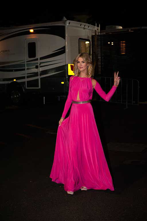 This fuchsia jersey gown by Constantina & Louise may have covered Delta hand to foot, but the subtle shoulder and torso cut-outs revealed just enough flesh to keep it sexy.