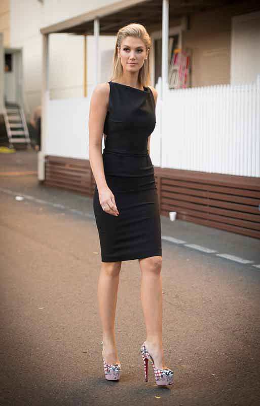 A sleek, sophisticated ensemble. Delta teamed a chic Roland Mouret LDB with printed Christian Louboutin pumps.