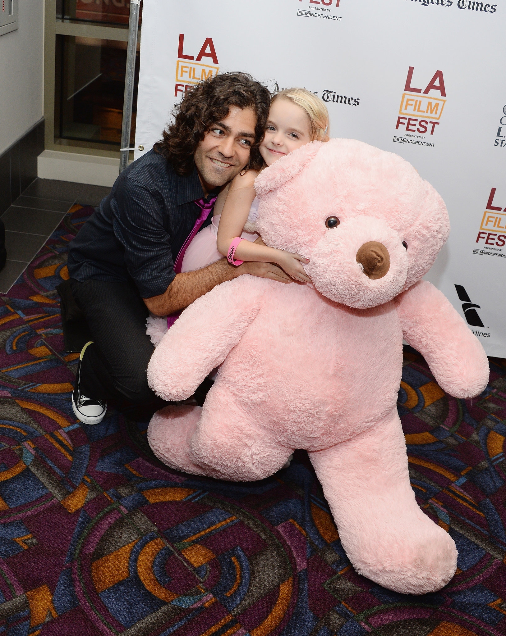 Adrian Grenier got cute with McKenna Grace and a giant pink bear at the Goodbye World premiere.